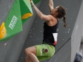 Munich, Germany – August 23: Juliane Wum (GER) is seen during the Womens Semi-Finals of the 2014 IFSC Climbing World Championships Bouldering. Bouldering is climbing without the need for ropes or harnesses on typically short, challenging routes. The World Championships are held under the rooftop of the famous Munich Olympic Stadium. Built for the 1972 Olympic Summer Games the architecture was considered revolutionary for its time. The roof, made of large sweeping canopies of acrylic glass stabilized by steel cables should symbolize the Alps.  (Photo Marco Kost / DAV)