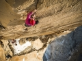 Mayan Smith-Gobat climbing pitch 31 (7c+) in the route riders on the storm, Torres del Paine (c) Thomas Senf
